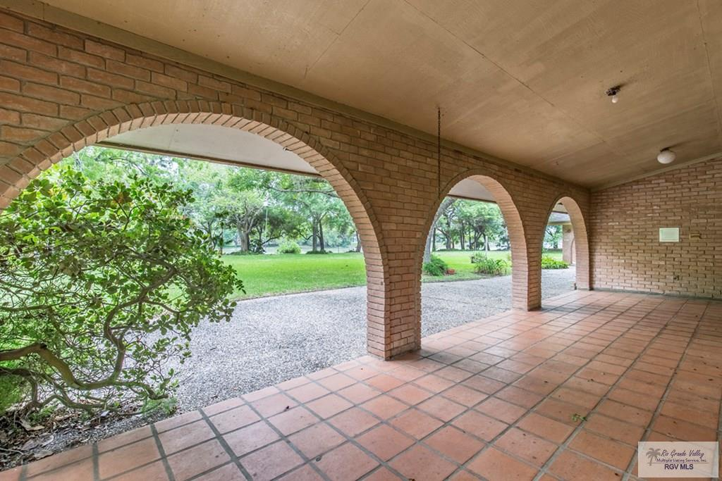 View of large covered patio with arches